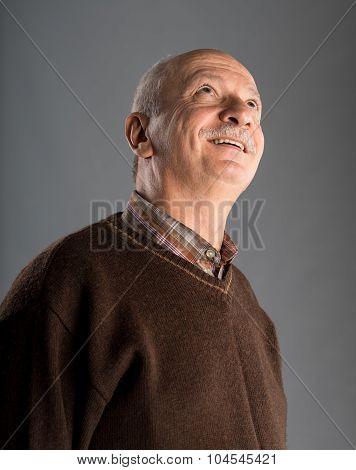 Senior Smiling Man Looking Up