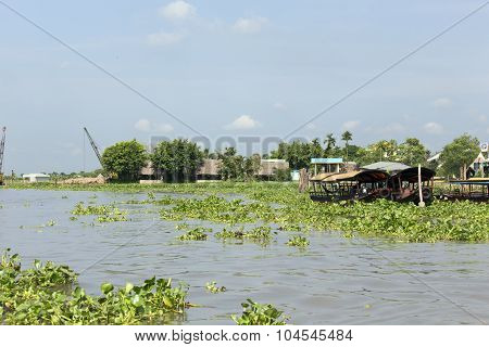 Fresh Produce Vendors Sell From Boat To Boat At The Cai Rang Floating Market, Vietnam