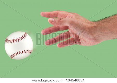A hand throwing a baseball