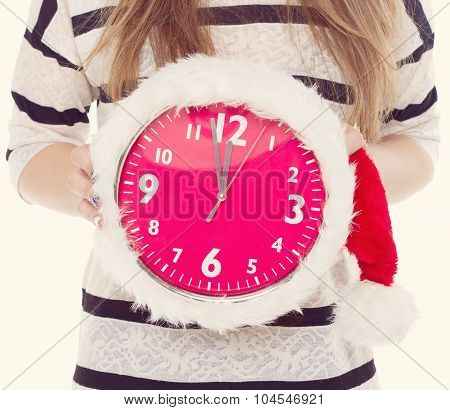 Big Clocks A Christmas Hat In Female Hands. New Year. 12 Hours. Toning