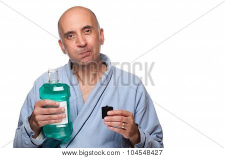 Man rinsing with mouthwash