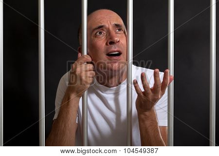 Man asking for mercy in prison