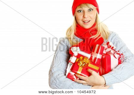 Young woman holding many gift boxes