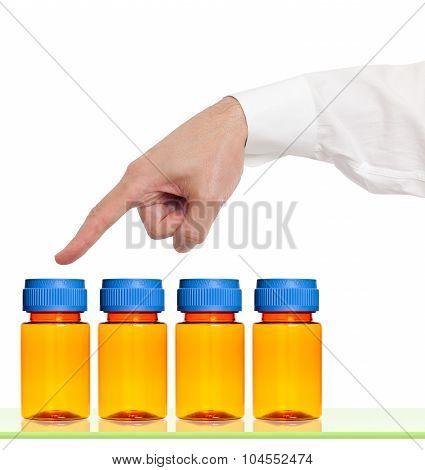 Finger points to empty medicine bottles.