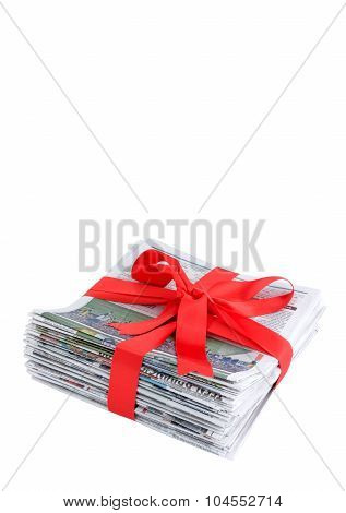 Newspaper stack with red bow