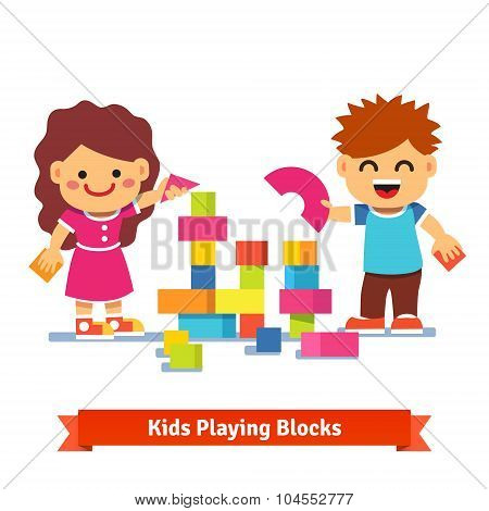 Kids building tower with colorful wooden blocks