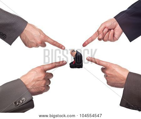 Hands pointing at a business man