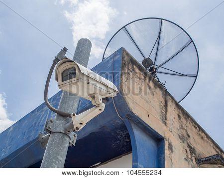 Satellite Dish And Ccvt Camera On Bright Sky Background.satellite Dish Communication Technology.