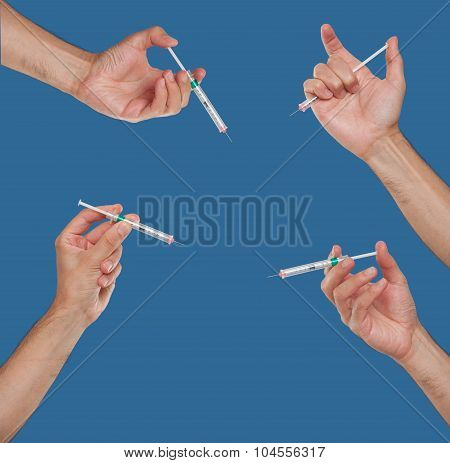 Hands holding syringes