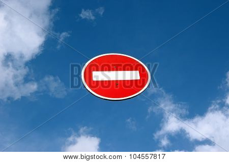 Directions Closed Road Sign Against The Blue Sky. White Brick Rectangle In The Red Circle