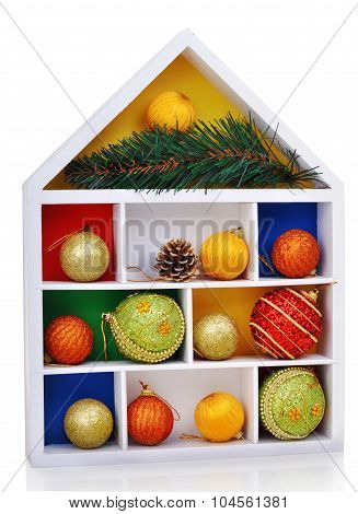 Wooden white case with christmas tiys and baubles