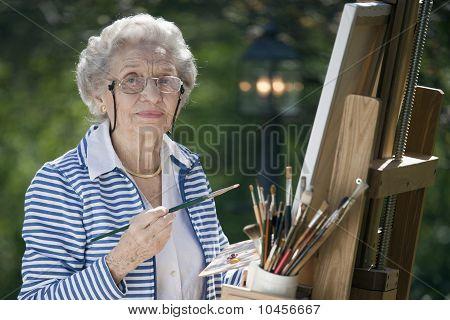 Smiling Senior Woman Painting