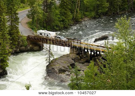 Truck And Trailer Crossing A River