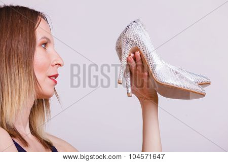 Stylish Woman Fashion Girl Holds High Heels Shoes