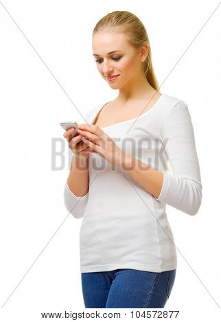 Young girl writing message on mobile phone isolated