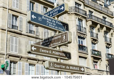Street sign with directions in Paris