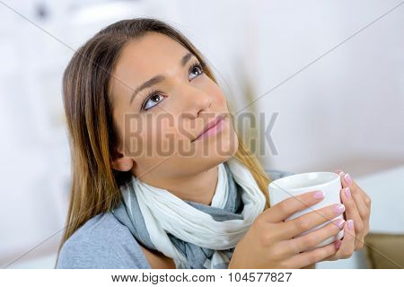 Lady with cup, daydreaming