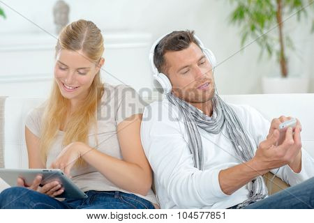 Couple using their gadgets