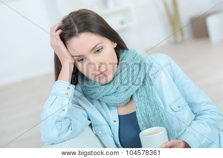 Sad woman holding a mug of coffee