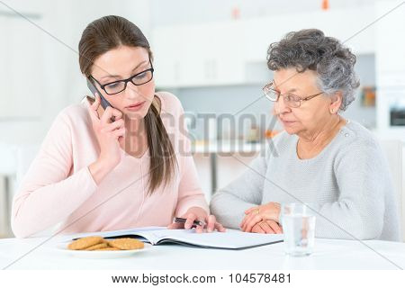 Helping senior lady with her finances