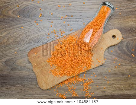 Red Lentils On The Wooden Cutting Board
