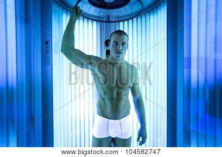 Handsome young men in modern solarium
