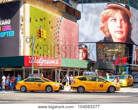 NEW YORK,USA - AUGUST 15,2015 : Yellow cabs and colorful billboards at Times Square in New York City