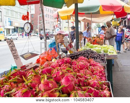 NEW YORK,USA - AUGUST 21,2015 : Chinese immigrants selling fruit at Chinatown in New York City