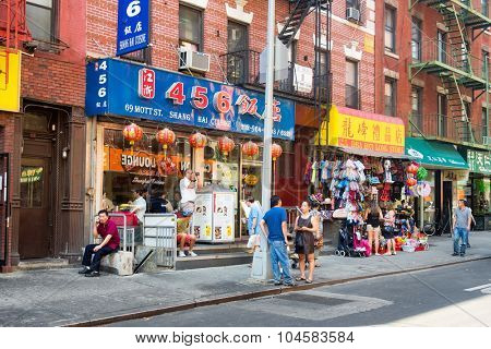 NEW YORK,USA - AUGUST 15,2015 : Asian immigrants at Chinatown in New York City