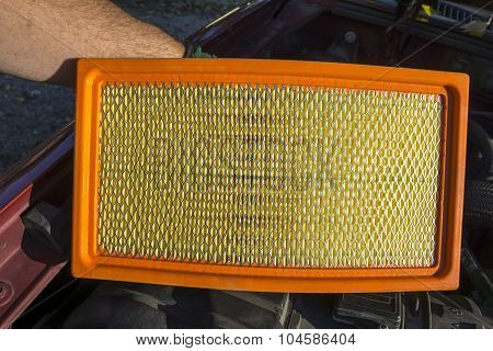Mechanic With A New Air Filter
