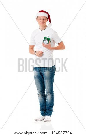 Man wearing a Santa hat with green alarm clock, isolated on white background