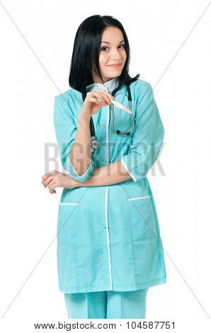 Happy young female doctor with pregnancy test, looking at camera