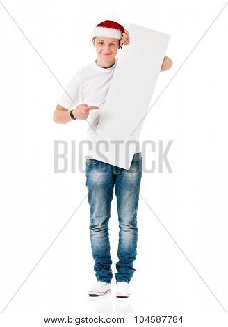 Smiling man in Santa Claus hat holding white board with space for text