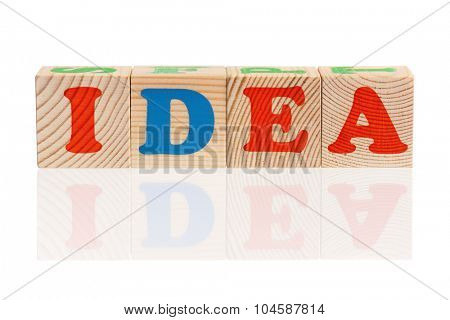 IDEA word formed by wood alphabet blocks, isolated on white background