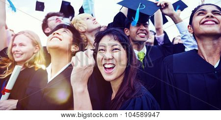 Graduation Caps Thrown in the Air Celebration Concept