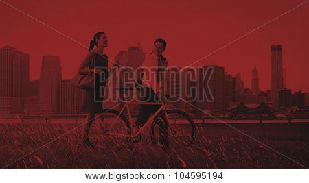 Business Man Woman Pushing Bike City Concept