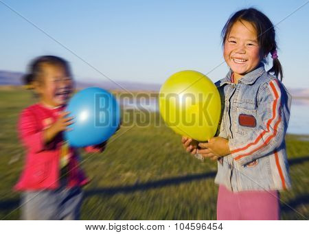 Asian Girls Playing Lake Balloon Rural Mongolian Concept