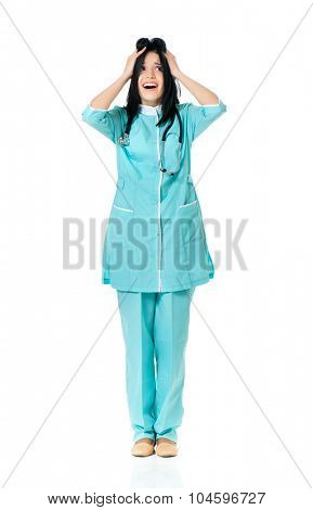 Young female doctor shocked, isolated on white background