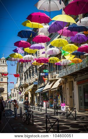 Street Decorated With Colored Umbrellas. Arles, Provence. France