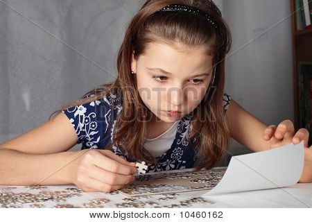Teenage girl concentrates on puzzle