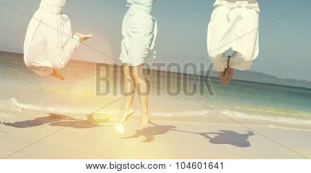 Friends Beach Jumping Happiness Concept