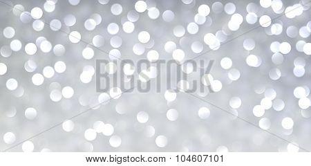 Silver christmas banner. Defocused lights. Vector illustration.
