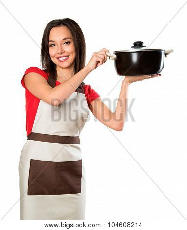 Beautiful Brunette Woman Housewife Holding Pan. Studio Shot Over White Background.