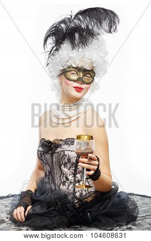 Masquerade In Venice. Princess In A Black Dress With A Glass Of Wine.