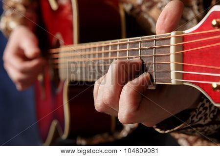 Guitarist Playing An Acoustic Guitar