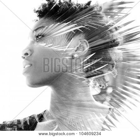 Double exposure portrait of attractive woman combined with photograph of palm tree