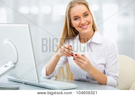 Portrait of a young business with cup of coffee