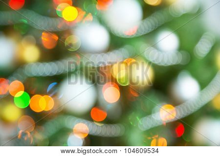 Christmas background of de-focused lights with decorated tree
