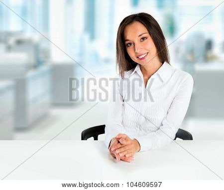 Woman Sitting At Table Smiling At Camera. Beautiful Young Businesswoman (mixed Asian Chinese / White