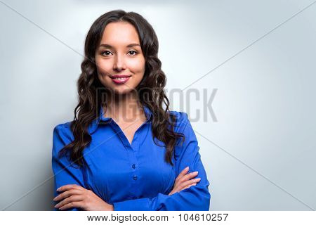 Smiling Business Woman Blue Suit Dressed Standing Against White Background With Crossed Arms. Copy S